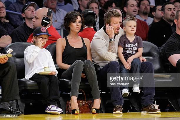 Cruz Beckham Victoria Beckham David Beckham and Romeo Beckham attend the Los Angeles Lakers vs Dallas Mavericks game on October 30 2009 in Los...