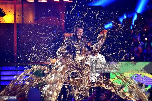 Cruz David Beckham former soccer player David Beckham and Romeo James Beckham get slimed onstage during Nickelodeon Kids' Choice Sports Awards 2014...