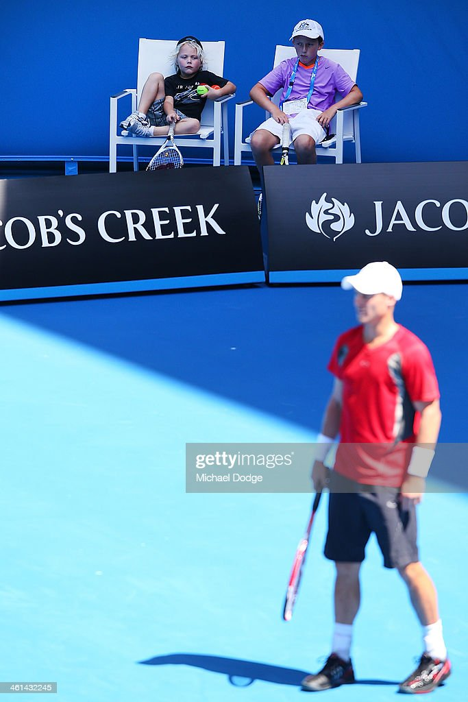Cruz Hewitt (L) watches his dad Lleyton Hewitt of Australia at his training session ahead of the 2014 Australian Open at Melbourne Park on January 9, 2014 in Melbourne, Australia.