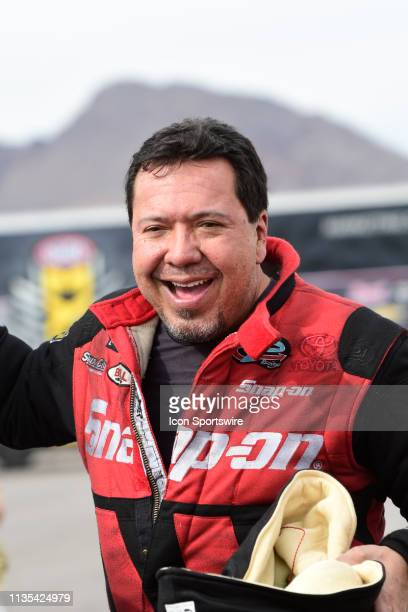 Cruz Pedregon Dodge Charger STR Hellcat NHRA Funny Car driver smiles at the conclusion of qualifying for the 20th Annual DENSO 4Wide Nationals Friday...