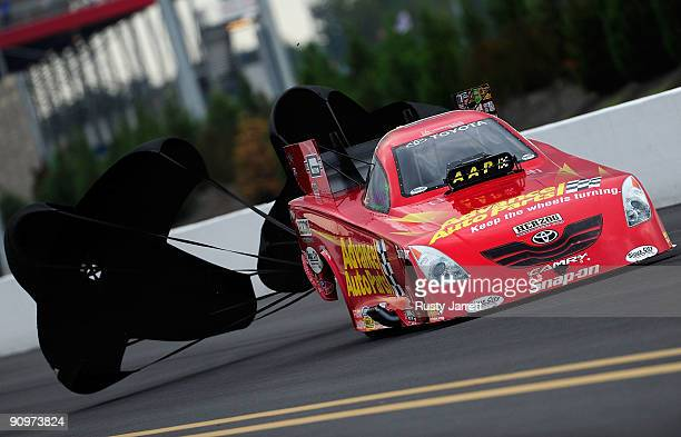 Cruz Pedregon driver of the Advance Auto Parts Toyota funny car drives during qualifying for the NHRA Carolinas Nationals on September 19 2009 at...
