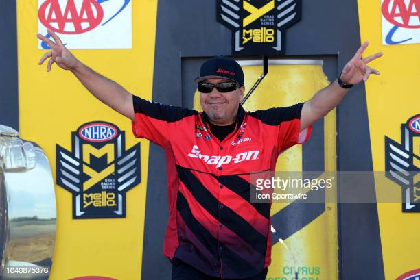Cruz Pedregon Toyota Camry NHRA Funny Car is introduced to the crowd during prerace festivities before the start of the NHRA AAA Midwest Nationals on...