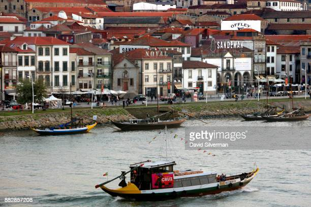 Cruz port house Rabelo boat a traditional Portuguese wooden cargo boats used for centuries to transport people and goods along the Douro River passes...