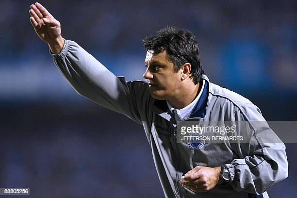Cruzeiro's head coach Adilson Batista shouts instructions to his team during their Libertadores Cup semifinal match with Gremio at Olimpico...