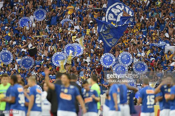 Cruzeiro's players and supporters celebrate at the end of their Brazilian Championship football match against fluminense at Minerao Stadium in Belo...