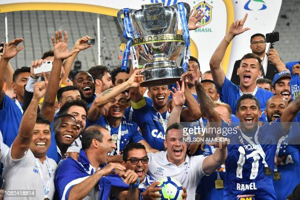 Cruzeiro's players celebrate with the trophy after defeating by penalty shots Corinthians to win the Brazil Cup at Arena Corinthians stadium in Sao...