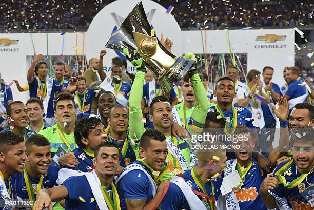Cruzeiro's players celebrate with the trophy at the end of their Brazilian Championship football match against fluminense at Minerao Stadium in Belo...