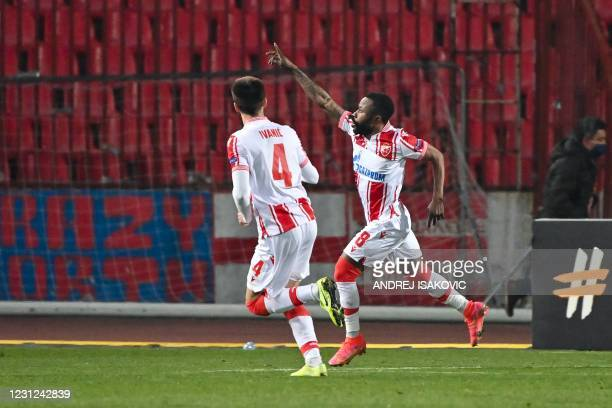 Crvena Zvezda Beograd's Gabonese midfielder Guelor Kanga Kakou celebrates after scoring a penalty during the UEFA Europa League round of 32 football...