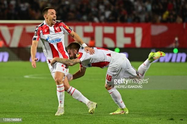 Crvena Zvezda Beograd's Serbian defender Milan Rodic celebrates with Crvena Zvezda Beograd's Serbian midfielder Aleksandar Katai after scoring a goal...
