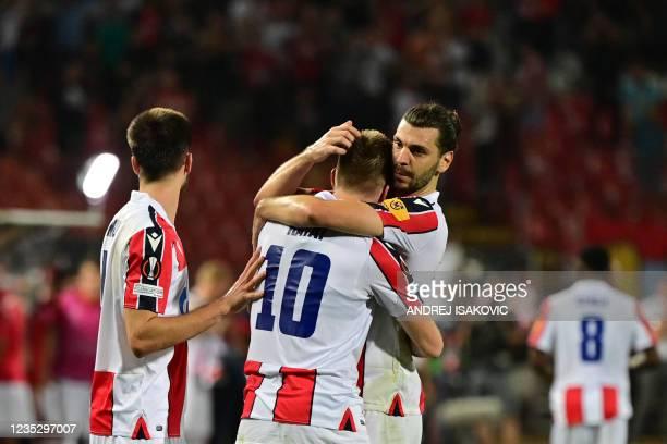 Crvena Zvezda Beograd's Serbian midfielder Aleksandar Katai celebrates with Crvena Zvezda Beograd's Austrian defender Aleksandar Dragovi? after...