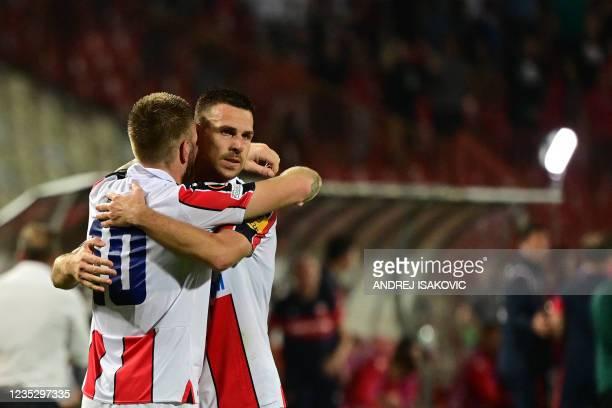 Crvena Zvezda Beograd's Serbian midfielder Aleksandar Katai celebrates with teammate after scoring a goal during the UEFA Europa League Group F...
