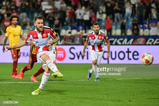 Crvena Zvezda Beograd's Serbian midfielder Aleksandar Katai shoots a penalty kick and scores a goal during the UEFA Europa League Group F football...