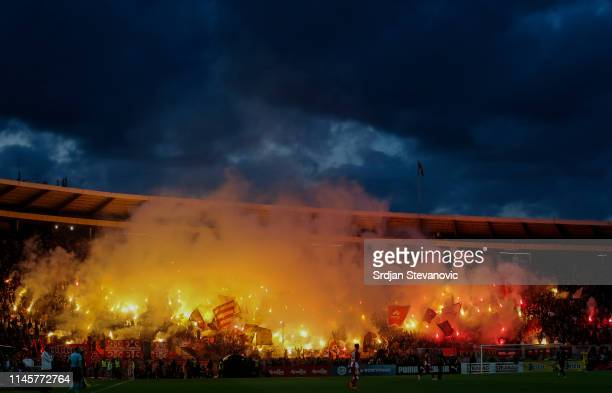 Crvena Zvezda fans light torches during the Serbian Cup Final match between FK Crvena Zvezda and FK Partizan at stadium Rajko Mitic on May 23, 2019...