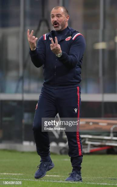 Crvena Zvezda head coach Dejan Stankovic issues instructions to his players during the UEFA Europa League Round of 32 match between AC Milan and...