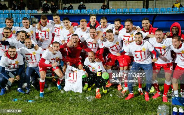 Crvena Zvezda players celebrate winning the Championship title of Serbia after the LingLong Super League match between FC Rad and FK Crvena Zvezda on...