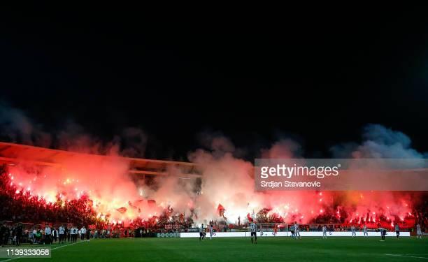 Crvena Zvezda soccer fans light flares during the Super League match between FK Crvena Zvezda and FK Partizan at stadium Rajko Mitic on April 25,...