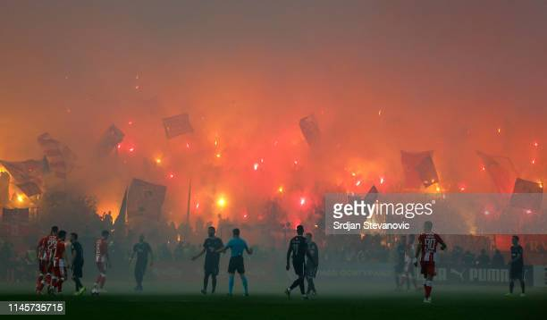 Crvena Zvezda supporters light torches during the Serbian Cup Final match between FK Crvena Zvezda and FK Partizan at stadium Rajko Mitic on May 23,...
