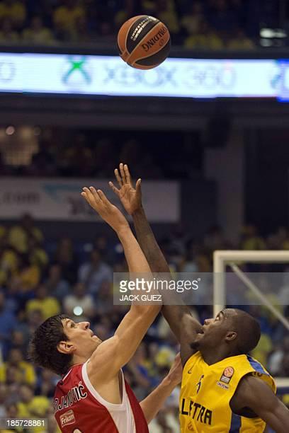 Crvena Zvezda Telekom Belgrade's center Boban Marjanovic vies with Maccabi Tel Avivs center Shawn James during their Euroleague Playoff basketball...