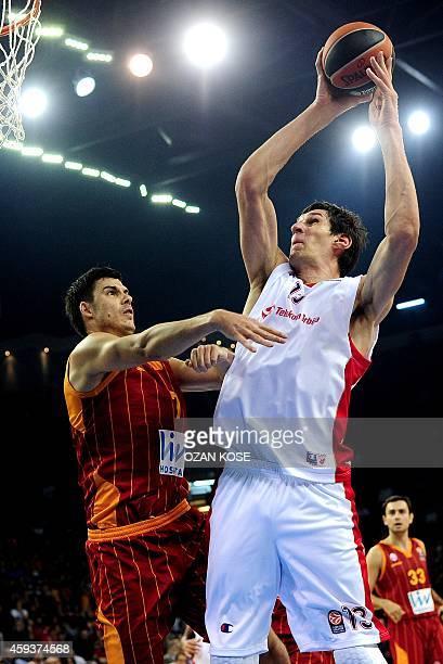 Crvena Zvezda Telekom Belgrade's Serbian center Boban Marjanovic vies with Galatasaray Liv's Serbian Zoran Erceg during the Euroleague basketball...