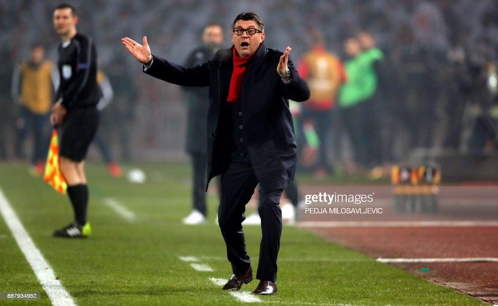Crvena Zvezda's head coach Vladan Milojevic gestures during the UEFA Europa League football match between Red Star Belgrade (Crvena zvezda) and FC Koln in Belgrade on December 7, 2017. / AFP PHOTO / Pedja MILOSAVLJEVIC