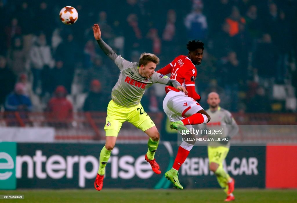Crvena Zvezda's Richmond Boakye (R) fights for the ball with Koln's Jannes-Kilian Horn during the UEFA Europa League football match between Red Star Belgrade (Crvena zvezda) and FC Koln in Belgrade on December 7, 2017. / AFP PHOTO / Pedja MILOSAVLJEVIC