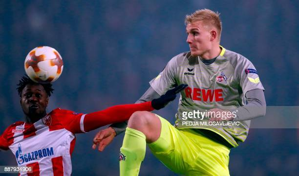 Crvena Zvezda's Richmond Boakye fights for the ball with Koln's Frederik Sorensen during the UEFA Europa League football match between Red Star...