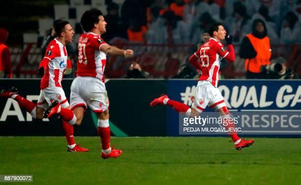 Crvena Zvezda's Slavoljub Srnic celebrates after scoring a goal with teammates Filip Stojkovic and Branko Jovicic during the UEFA Europa League...