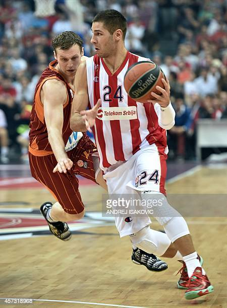 Crvena Zvezda's Stefan Jovic vies for the ball with Galatasaray's Martynas Pocius during the Euroleague basketball match between Crvena Zvezda...