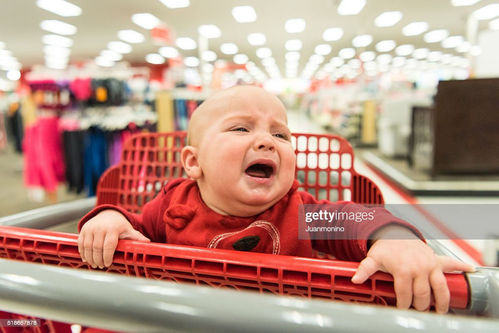Crying Baby in a shopping cart : Stock Photo