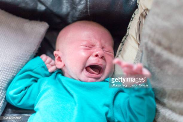 crying baby - s0ulsurfing stock pictures, royalty-free photos & images