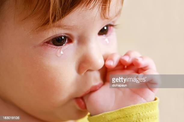 crying baby - conjunctivitis stock pictures, royalty-free photos & images