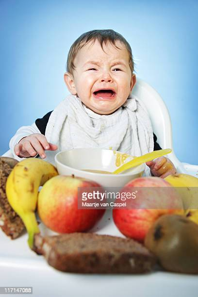 Crying Baby with Healthy Food