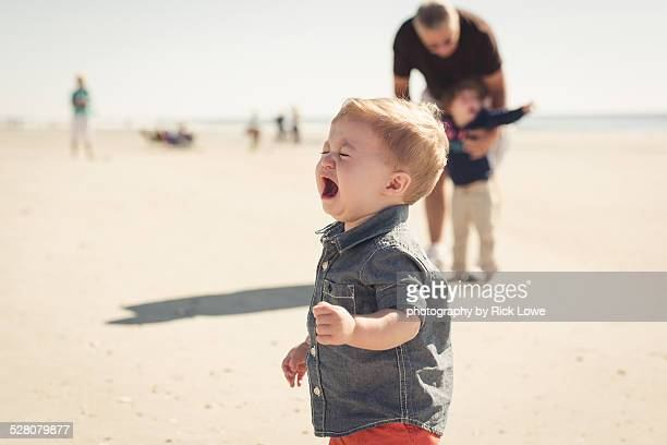 Crying child at the beach