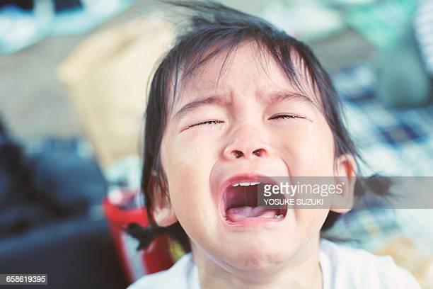 crying children - huilen gezichtsuitdrukking stockfoto's en -beelden