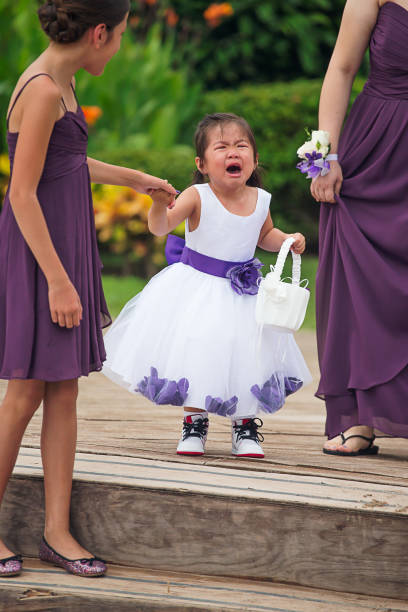 crying flower girl walking down - kid crying in wedding stock pictures, royalty-free photos & images