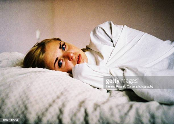 Crying girl on bed