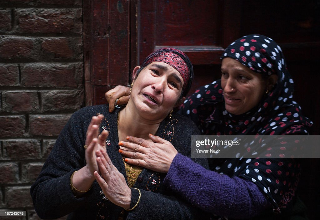 A crying Kashmiri Muslim woman is consoled her after a fire that gutted residential houses on November 07, 2013, in Srinagar the summer capital of Indian administered Kashmir, India. Several families were left homeless in Maharaja Bazar locality in uptown Srinagar and no injuries were reported.