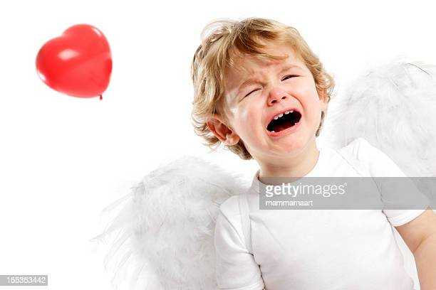 Crying little Angel & Heart shaped balloon; flying away