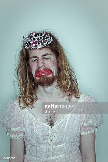 Crying man homecoming queen in drag tiara on head lipstick