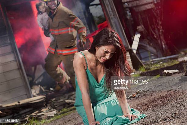 baby girl rescued from burning house by fireman, crying mother - mother and daughter smoking stock photos and pictures