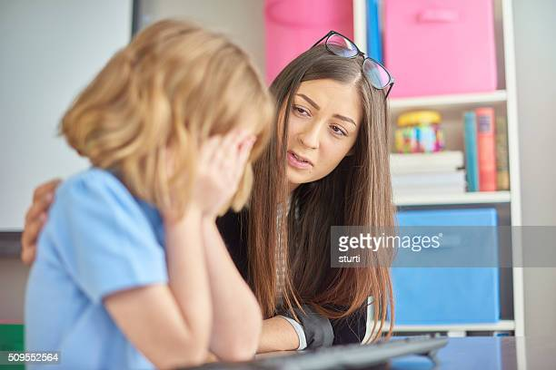 crying schoolgirl - consoling stock pictures, royalty-free photos & images