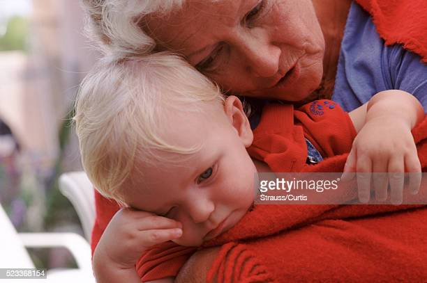 Crying toddler with his grandmother
