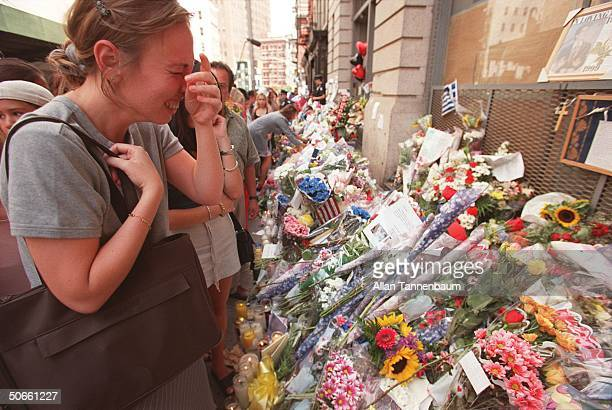Crying woman among mourners paying respects at floral shrine outside loft bldg where John F Kennedy Jr wife Carolyn lived in public outpouring of...
