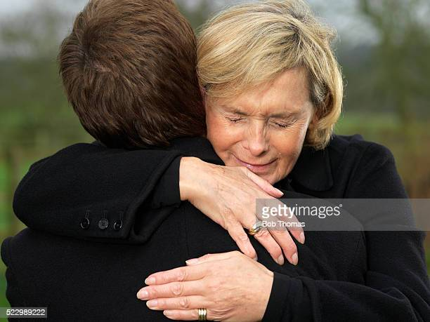 Crying Woman Hugging Man