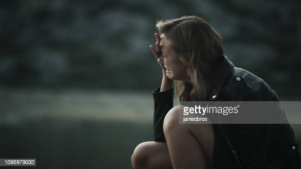 crying woman. loneliness in the wild - grief stock pictures, royalty-free photos & images