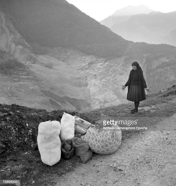 A crying woman stands with all that is left of her belongings Longarone near the Vajont Dam in the Piave Valley Italy early October 1963 On October 9...