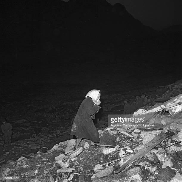 A crying woman wanders around the rubble Longarone near the Vajont Dam in the Piave Valley Italy early October 1963 On October 9 a landslide in the...