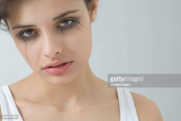 crying woman with smeared mascara - mascara stock pictures, royalty-free photos & images