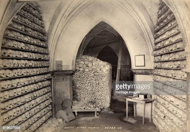Crypt St Leonard's Church Hythe Kent circa 1900 This image shows the ossuary or bone store in the vaulted ambulatory beneath the chancel of the...