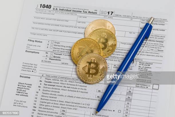 crypto-currency and taxes - 1040 tax form stock photos and pictures
